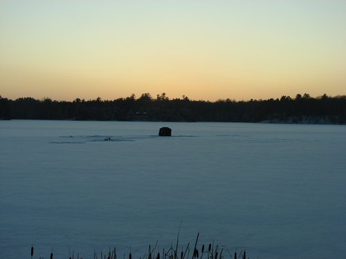 Ice fishing at Sunsent