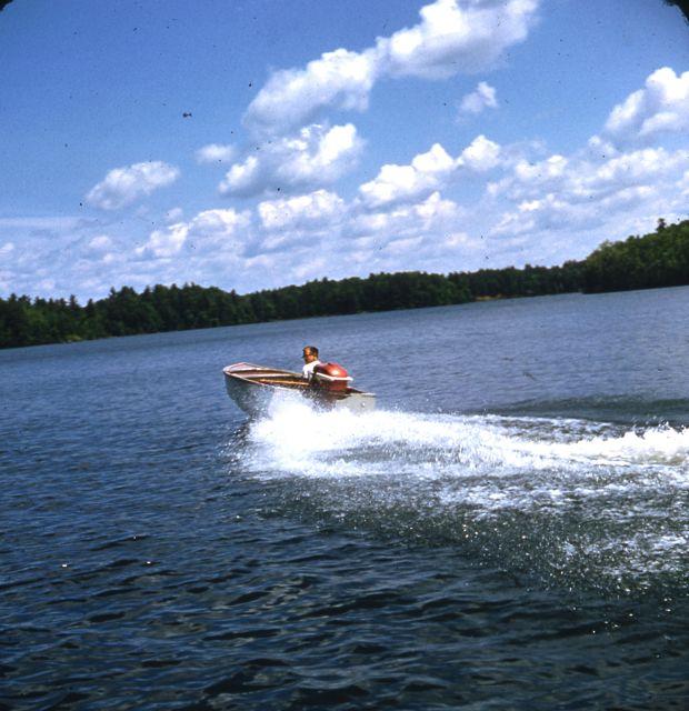 1958 Craig driving boat
