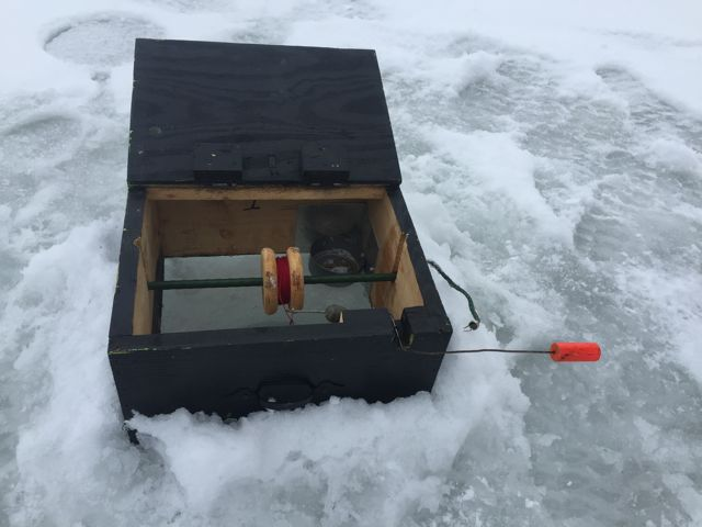 Ice fishing walk about black 39 s cliff resort 39 s birch bark for Tip up fishing